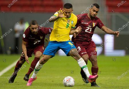 Gabriel Jesus of Brazil holds off the challenges from Yohan Cumana and Cristián Cásseres Jr. of Venezuela; Mane Garrincha Stadium, Brasilia, Distrito Federal, Brazil; Copa America, Brazil versus Venezuela.