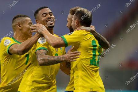 Neymar of Brazil celebrates his penalty kick goal with Gabriel Jesus and Éverton Ribeiro in the 64th minute 2-0; Mane Garrincha Stadium, Brasilia, Distrito Federal, Brazil; Copa America, Brazil versus Venezuela.