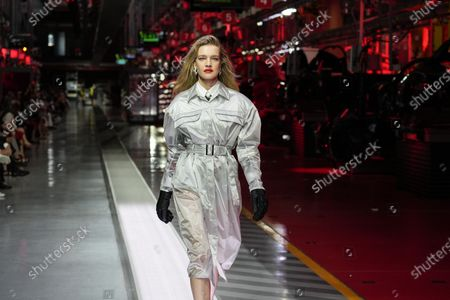 Model Natalia Vodianova wears a creation as part of the Ferrari women's and men's Spring Summer 2022 collection, in Maranello, Italy