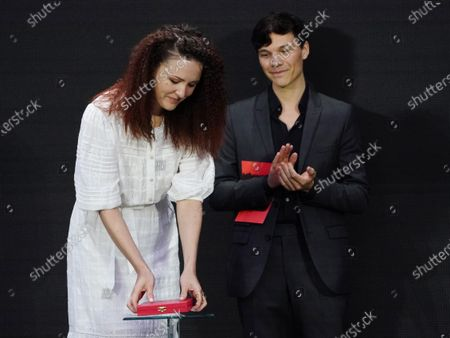 Olga Lucovnicova (L), winner of the Golden Bear for the Best Short Film for their movie 'Nanu Tudor' (My Uncle Tudor) is applauded by and  Sebastian Urzendowsky (R) of the Short Film jury as she receives her award during the Berlin Film Festival (Berlinale) awards ceremony in Berlin, Germany, 13 June 2021. Due to the coronavirus COVID-19 pandemic, the 71st Berlinale is taking place in two stages: a virtual Industry Event, that was held from 01 to 05 March 2021, and the Summer Special for the general public running from 09 to 20 June 2021 as an outdoor-only event.