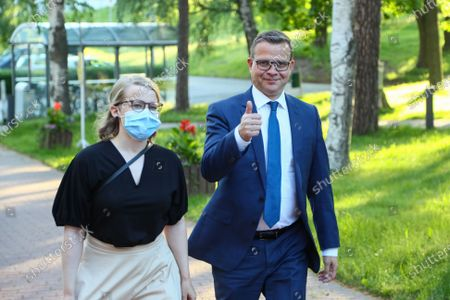 Stock Picture of Leader of the National Coalition Party Petteri Orpo (R) during the Finnish municipal election day in Helsinki, Finland, 13 June 2021.