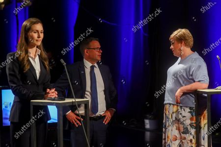 Prime Minister of Finland and leader of the Social Democratic Party Sanna Marin (L), leader of the National Coalition Party Petteri Orpo (C) and leader of the Centre Party Annika Saarikko (R) during the Finnish municipal election day in Helsinki, Finland, 13 June 2021.