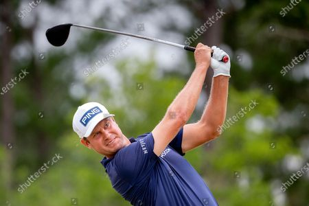 Stock Image of Harris English watches his drive off the third tee during the final round of the Palmetto Championship golf tournament in Ridgeland, S.C