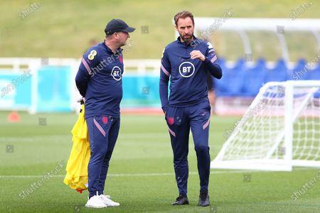 England manager Gareth Southgate speaks with assistant manager Steve Holland