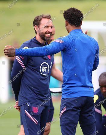 England manager Gareth Southgate shares a joke with Marcus Rashford of England