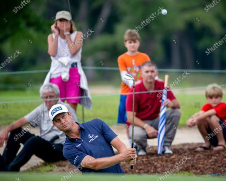 Stock Picture of Harris English hits out of the bunker on the second green during the final round of the Palmetto Championship golf tournament in Ridgeland, S.C
