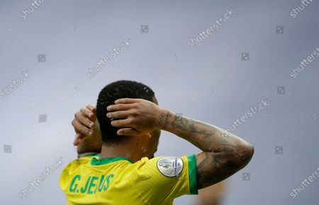 Stock Photo of Brazil's Gabriel Jesus holds his head during a Copa America soccer match against Venezuela at the National Stadium in Brasilia, Brazil