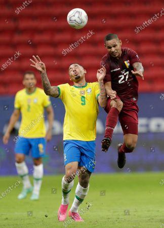 Brazil's Gabriel Jesus, left, and Venezuela's Yohan Cumana battle for the ball during a Copa America soccer match at the National Stadium in Brasilia, Brazil