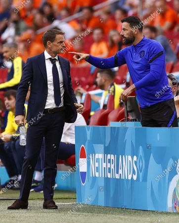 Netherlands head coach Frank de Boer (L) and his assistant Ruud van Nistelrooy (R) react during the UEFA EURO 2020 preliminary round group C match between the Netherlands and Ukraine in Amsterdam, Netherlands, 13 June 2021.