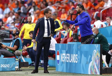 Stock Photo of Netherlands head coach Frank de Boer (L) and his assistant Ruud van Nistelrooy (R) react during the UEFA EURO 2020 preliminary round group C match between the Netherlands and Ukraine in Amsterdam, Netherlands, 13 June 2021.