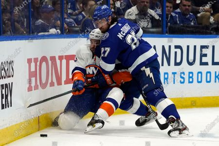 Stock Picture of Tampa Bay Lightning defenseman Ryan McDonagh (27) drives New York Islanders center Mathew Barzal (13) into the dasher during the third period in Game 1 of an NHL hockey Stanley Cup semifinal playoff series, in Tampa, Fla