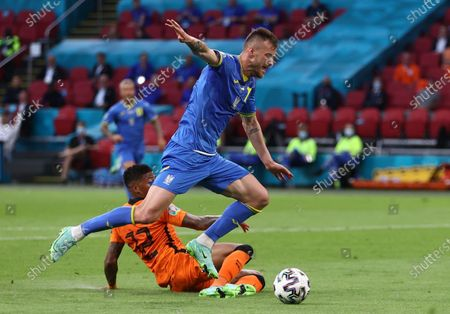 Patrick van Aanholt (L) of the Netherlands in action against Andriy Yarmolenko of Ukraine during the UEFA EURO 2020 preliminary round group C match between the Netherlands and Ukraine in Amsterdam, the Netherlands, 13 June 2021.