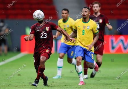 Stock Image of Brazil's Gabriel Jesus (R) in action against Venezuela's Cristian Casseres, during the opening match of the Copa America 2021 between Brazil and Venezuela, at the Mane Garrincha Stadium in Brasilia, Brazil, 13 June 2021.