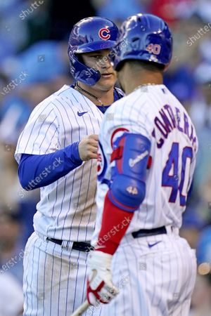 Chicago Cubs' Joc Pederson, left, celebrates Willson Contreras after scoring on a one-run single by Anthony Rizzo during the third inning of a baseball game against the St. Louis Cardinals in Chicago