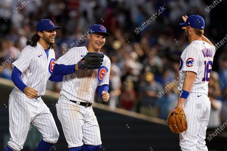 Chicago Cubs third baseman Patrick Wisdom, right, celebrates with left fielder Joc Pederson and center fielder Jake Marisnick after the Chicago Cubs defeated the St. Louis Cardinals 2-0 in a baseball game in Chicago