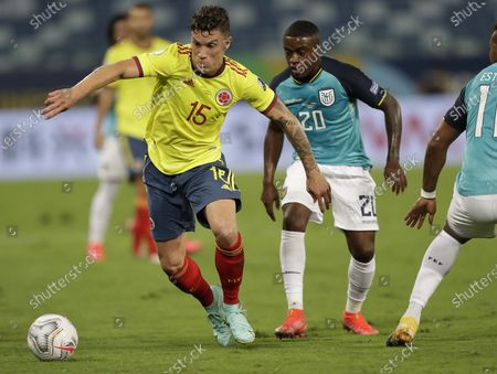 Colombia's Mateus Uribe, left, and Ecuador's Jhegson Mendez fight for the ball during a Copa America soccer match at Arena Pantanal stadium in Cuiaba, Brazil