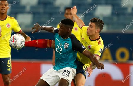 Ecuador's Moises Caicedo, center, and Colombia's Mateus Uribe battle for the ball during a Copa America soccer match at Arena Pantanal stadium in Cuiaba, Brazil
