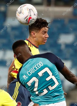Mateus Uribe (top) of Colombia vies for the ball with Moises Caicedo of Ecuador during the Copa America group A preliminary round soccer match between Colombia and Ecuador at Arena Pantanal stadium in Cuiaba, Brazil, 13 June 2021.