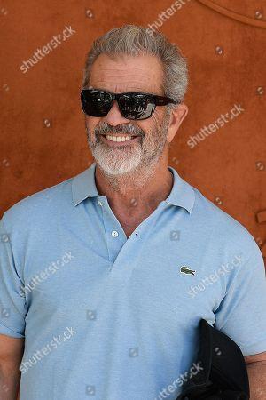 Mel Gibson poses at the VIP Village
