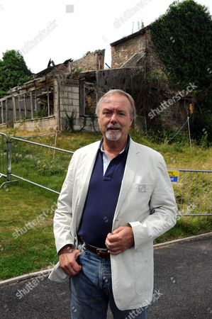 Sir Terry Matthews by the Little Bulmore farmhouse, the derelict building