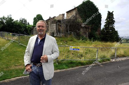 Sir Terry Matthews by the Little Bulmore farmhouse, the derelict building at the Twenty Ten Golf Course