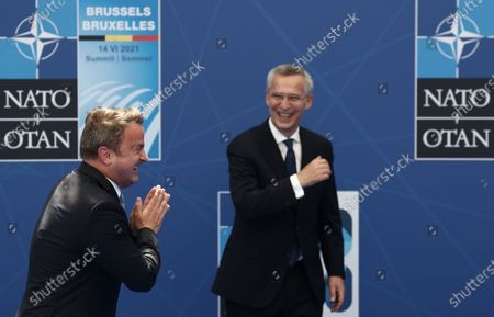 Luxembourg's Prime Minister Xavier Bettel (L) is greeted by NATO Secretary General Jens Stoltenberg (R) during a NATO summit at the North Atlantic Treaty Organization (NATO) headquarters in Brussels, Belgium, 14 June 2021. The 30-nation alliance hopes to reaffirm its unity and discuss increasingly tense relations with China and Russia, as the organization pulls its troops out after 18 years in Afghanistan.