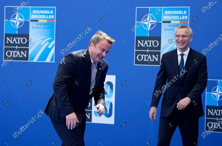 NATO Secretary General Jens Stoltenberg (R) greets Luxembourg's Prime Minister Xavier Bettel during arrivals for a NATO summit at the North Atlantic Treaty Organization (NATO) headquarters in Brussels, Belgium, 14 June 2021. The 30-nation alliance hopes to reaffirm its unity and discuss increasingly tense relations with China and Russia, as the organization pulls its troops out after 18 years in Afghanistan.