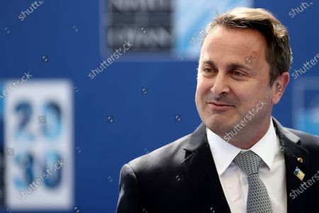 Luxembourg's Prime Minister Xavier Bettel arrives for a NATO summit at NATO headquarters in Brussels, . U.S. President Joe Biden is taking part in his first NATO summit, where the 30-nation alliance hopes to reaffirm its unity and discuss increasingly tense relations with China and Russia, as the organization pulls its troops out after 18 years in Afghanistan