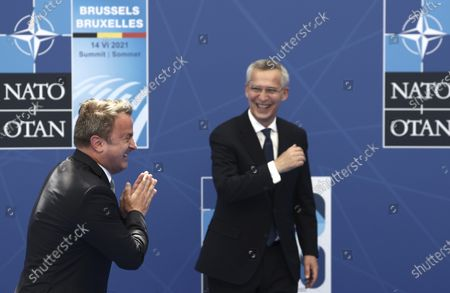 Secretary General Jens Stoltenberg greets Luxembourg's Prime Minister Xavier Bettel during arrivals for a NATO summit at NATO headquarters in Brussels, . U.S. President Joe Biden is taking part in his first NATO summit, where the 30-nation alliance hopes to reaffirm its unity and discuss increasingly tense relations with China and Russia, as the organization pulls its troops out after 18 years in Afghanistan