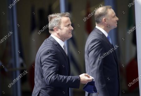 Stock Image of Luxembourg's Prime Minister Xavier Bettel (C) arrives for a NATO summit at the North Atlantic Treaty Organization (NATO) headquarters in Brussels, Belgium, 14 June 2021. The 30-nation alliance hopes to reaffirm its unity and discuss increasingly tense relations with China and Russia, as the organization pulls its troops out after 18 years in Afghanistan.