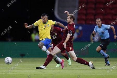 (210614) - BRASILIA, June 14, 2021 (Xinhua) - Brazil's Gabriel Jesus (L) vies with Venezuela's Fernando Aristeguieta during the Group B match between Brazil and Venezuela at the 2021 Copa America in Brasilia, Brazil, June 13, 2021.
