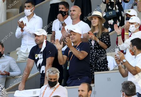 Stock Photo of From left, Miljan Amanovic, physio of Novak Djokovic of Serbia, his coach Marian Vajda, his wife Jelena Djokovic celebrate following Novak's victory in the men's final