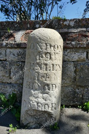 An old stone mileage sign outside Dorchester Abbey