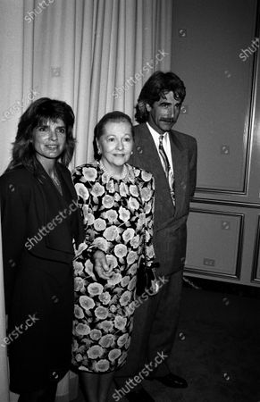 UNITED STATES - DECEMBER 01:  Edward James Olmos, Joan Fontaine, and guest