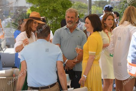 Stock Photo of Mel Gibson, Jean Dujardin and Nathalie Pechalat sighted at the VIP Village of Roland Garros