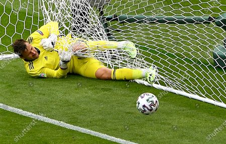 Scotland's goalkeeper David Marshall is caught in the goal's net after he failed to safe a long distance shot by Czech Republic's Patrik Schick during the Euro 2020 soccer championship group D match between Scotland and Czech Republic at Hampden Park stadium in Glasgow