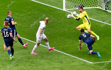 Scotland's goalkeeper David Marshall, right, saves a shot by Czech Republic's Michael Krmencik, center, during the Euro 2020 soccer championship group D match between Scotland and Czech Republic at Hampden Park stadium in Glasgow