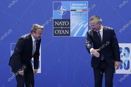 Luxembourg's Prime Minister Xavier Bettel laughs as he poses for photos with NATO Secretary General Jens Stoltenberg at the NATO summit at NATO headquarters in Brussels