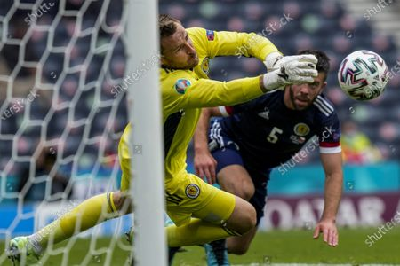 Scotland's goalkeeper David Marshall dives to deflect the ball during the Euro 2020 soccer championship group D match between Scotland and Czech Republic, at Hampden Park stadium in Glasgow, Scotland