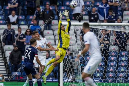 Scotland's goalkeeper David Marshall, second right, dives to catch the ball during the Euro 2020 soccer championship group D match between Scotland and Czech Republic, at Hampden Park stadium in Glasgow, Scotland