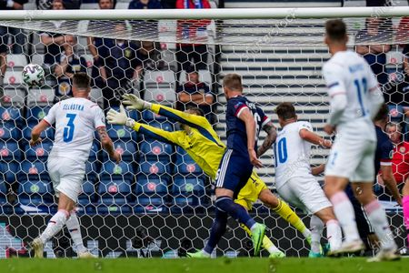 Scotland's goalkeeper David Marshall dives for the ball but fails to stop the opening goal during the Euro 2020 soccer championship group D match between Scotland and Czech Republic, at Hampden Park stadium in Glasgow, Scotland