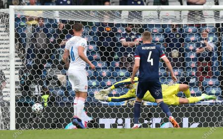 Goalkeeper David Marshall (rear) of Scotland concedes the 0-1 goal during the UEFA EURO 2020 group D preliminary round soccer match between Scotland and the Czech Republic in Glasgow, Britain, 14 June 2021.