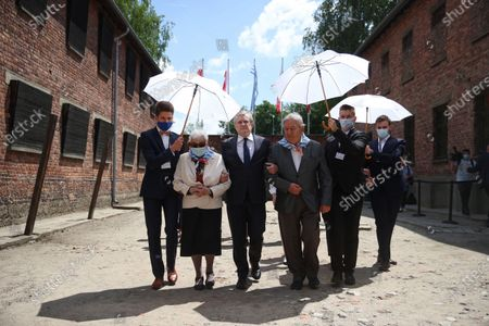 Deputy Prime Minister of Poland, Minister of Culture, National Heritage & Sport Piotr Glinski (3L) and KL Auschwitz prisoners Bogdan Bartnikowski (4L) and Zdzislawa Wlodarczyk (2L) during the ceremony at the former German nazi concentration and extermination camp Auschwitz and Birkenau in Oswiecim, south Poland, 14 June 2021. Celebrations of the 81st anniversary of the first transport of Polish prisoners to KL Auschwitz are underway.