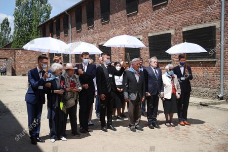 Deputy Prime Minister of Poland, Minister of Culture, National Heritage & Sport Piotr Glinski (3R) and KL Auschwitz prisoners Bogdan Bartnikowski (4R) and Zdzislawa Wlodarczyk (2R) during the ceremony at the former German nazi concentration and extermination camp Auschwitz and Birkenau in Oswiecim, south Poland, 14 June 2021. Celebrations of the 81st anniversary of the first transport of Polish prisoners to KL Auschwitz are underway.