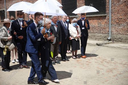 Deputy Prime Minister of Poland, Minister of Culture, National Heritage & Sport Piotr Glinski (4R) and KL Auschwitz prisoners Bogdan Bartnikowski (5R) and Zdzislawa Wlodarczyk (2R) during the ceremony at the former German nazi concentration and extermination camp Auschwitz and Birkenau in Oswiecim, south Poland, 14 June 2021. Celebrations of the 81st anniversary of the first transport of Polish prisoners to KL Auschwitz are underway.