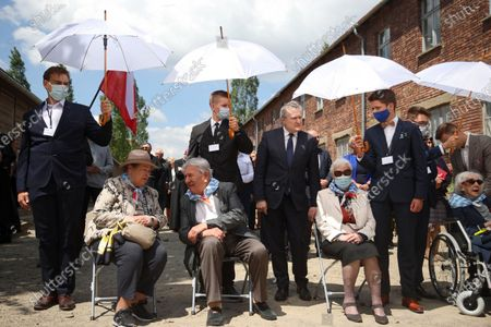 Deputy Prime Minister of Poland, Minister of Culture, National Heritage & Sport Piotr Glinski (C) and KL Auschwitz prisoners Bogdan Bartnikowski (6L) and Zdzislawa Wlodarczyk (2R) during the ceremony at the former German nazi concentration and extermination camp Auschwitz and Birkenau in Oswiecim, south Poland, 14 June 2021. Celebrations of the 81st anniversary of the first transport of Polish prisoners to KL Auschwitz are underway.