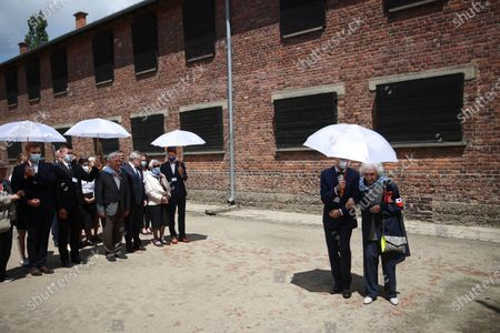 Deputy Prime Minister of Poland, Minister of Culture, National Heritage & Sport Piotr Glinski (6R) and KL Auschwitz prisoners Bogdan Bartnikowski (7R) and Zdzislawa Wlodarczyk (4R) during the ceremony at the former German nazi concentration and extermination camp Auschwitz and Birkenau in Oswiecim, south Poland, 14 June 2021. Celebrations of the 81st anniversary of the first transport of Polish prisoners to KL Auschwitz are underway.