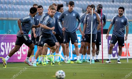 Germany's Ilkay Gundogan, front left, and Germany's Joshua Kimmich, front right, run during a team training session at Allianz Arena stadium in Munich, the day before the Euro 2020 soccer championship group F match between France and Germany