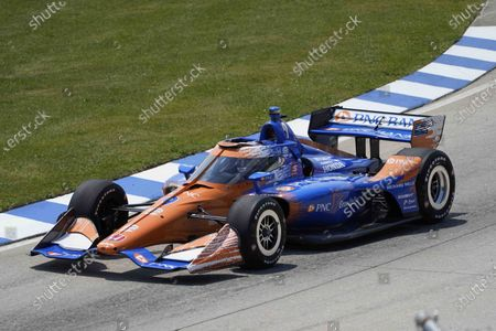 Scott Dixon (9) of New Zealand, races during the first race of the IndyCar Detroit Grand Prix auto racing doubleheader on Belle Isle in Detroit