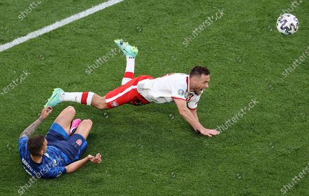 Maciej Rybus (top) of Poland in action against Lukas Haraslin of Slovakia during the UEFA EURO 2020 group E preliminary round soccer match between Poland and Slovakia in St. Petersburg, Russia, 14 June 2021.